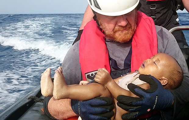 ATTENTION EDITORS - VISUAL COVERAGE OF SCENES OF INJURY OR DEATHA German rescuer from the humanitarian organisation Sea-Watch holds a drowned migrant baby, off the Libyan cost May 27, 2016. The baby, who appears to be no more than a year old, was pulled from the sea after a wooden boat capsized last Friday. Mandatory Credit Christian Buettner/Eikon Nord GmbH Germany/Handout via REUTERS ATTENTION EDITORS - THIS IMAGE WAS PROVIDED BY A THIRD PARTY. FOR EDITORIAL USE ONLY. NO RESALES. NO ARCHIVES. MANDATORY CREDIT. TEMPLATE OUT. THIS PICTURE WAS PROCESSED BY REUTERS TO ENHANCE QUALITY. AN UNPROCESSED VERSION HAS BEEN PROVIDED SEPARATELY. ORG XMIT: BER900R