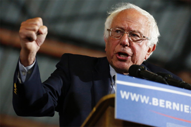 """Democratic presidential candidate Senator Bernie Sanders speaks during a rally at Barker Hangar in Santa Monica, California on June 7, 2016. Sanders refused to concede defeat to Hillary Clinton late on June 7, vowing to """"continue the fight"""" for the Democratic nomination despite his rival declaring herself the party's flagbearer for the US presidential race. / AFP PHOTO / JONATHAN ALCORN"""