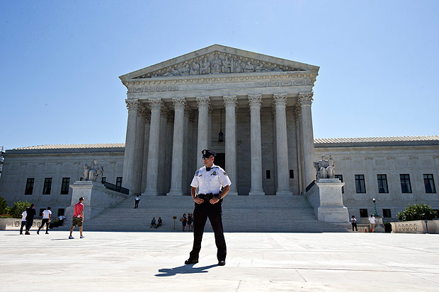 A Supreme Court police officer stands in front of the Supreme Court in Washington, Monday, June 20, 2016, as the court announced several decisions. (AP Photo/Alex Brandon) ORG XMIT: DCAB106