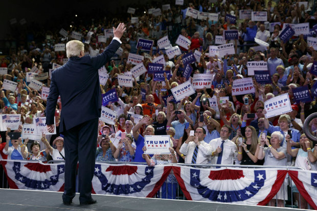 Republican presidential candidate Donald Trump waves to the crowd as he arrives at a campaign rally at the University of North Carolina Wilmington, Tuesday, Aug. 9, 2016, in Wilmington, N.C. (AP Photo/Evan Vucci)