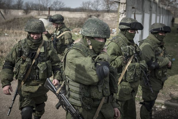 FILE -- Unidentified soldiers in Crimea, March 6, 2014. Russia reclaimed the territory from Ukraine, and Russian President Vladimir Putin later admitted that the troops were Russian special forces. Using both conventional media and covert channels, the Kremlin relies on disinformation to create doubt, fear and discord in Europe and the U.S. (Sergey Ponomarev/The New York Times) - XNYT8