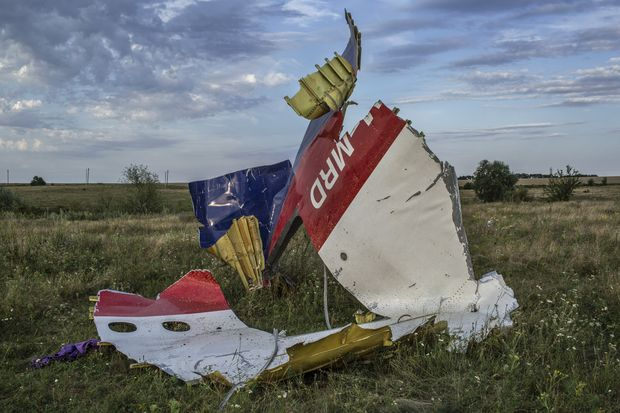 FILE -- Debris from Malaysia Airlines Flight 17, which was shot down over Ukraine in 2014 by insurgents using a missile supplied by Russia, in Grabovo, Ukraine, July 24, 2014. One of Russia's theories was that Ukrainian fighter pilots had downed the airliner after mistaking it for the Russian presidential aircraft. Using both conventional media and covert channels, the Kremlin relies on disinformation to create doubt, fear and discord in Europe and the U.S. (Mauricio Lima/The New York Times) - XNYT9