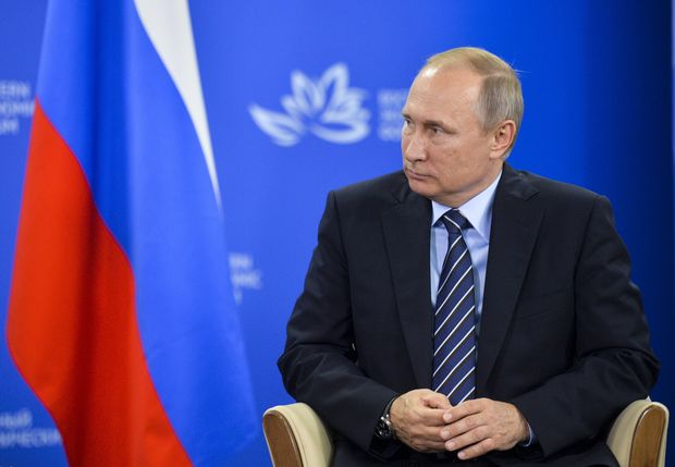 Russian President Vladimir Putin listens to Japanese Prime Minister Shinzo Abe during their meeting in Vladivostok, Russia, Friday, Sept. 2, 2016. Abe has been pushing for progress in the dispute over the Russian-held islands, called the Northern Territories in Japan and the southern Kurils in Russia. (Alexei Druzhinin, Sputnik, Kremlin Pool Photo via AP) ORG XMIT: XAZ109