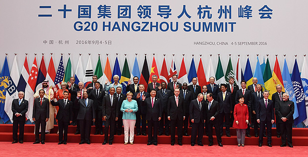 (Front row L-R) Brazil's President Michel Temer, Indonesia's President Joko Widodo, Mexico's President Enrique Pena Nieto, South Africa's President Jacob Zuma, US President Barack Obama, German Chancellor Angela Merkel, China's President Xi Jinping, Turkey's President Recep Tayyip Erdogan, Russia's President Vladimir Putin, French President Francois Hollande, South Korea's President Park Geun-Hye, Argentina's President Mauricio Macri, India's Prime Minister Narendra Modi; (2nd Row L-R) Saudi Arabia's Deputy Crown Prince and Minister of Defense Muhammad bin Salman Al Saud, Britain's Prime Minister Theresa May, Australia's Prime Minister Malcolm Turnbull, Italy's Prime Minister Matteo Renzi, Laos' President Bounnhang Vorachith, Kazakhstan's President Nursultan Nazarbayev, Chad's President Idriss Deby, Senegal's President Macky Sall, Egypt's President Abdel Fattah al-Sisi, Japan's Prime Minister Shinzo Abe, Canadian Prime Minister Justin Trudeau, European Council President Donald Tusk, President of the European Commission Jean-Claude Juncker; (3rd row L-R) Argentina's President Mauricio Macri, (unknown), IMF Managing Director Christine Lagarde, Thailand's Prime Minister Prayut Chan-O-Cha, Singapore's Prime Minister Lee Hsien Loong, Spain's Prime Minister Mariano Rajoy, UN Secretary-General Ban Ki-Moon, and three others pose for family photo in Hangzhou on September 4, 2016. World leaders are gathering in Hangzhou for the 11th G20 Leaders Summit from September 4 to 5. / AFP PHOTO / Greg BAKER