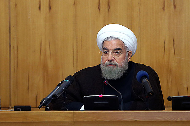 "In this photo released by official website of the office of the Iranian Presidency, Iranian President Hassan Rouhani speaks at a weekly cabinet meeting in Tehran, Iran, Wednesday, Sept. 7, 2016. Iran's President Hassan Rouhani says Islamic countries should take ""punitive"" measures against Saudi Arabia following the deaths of over two thousand pilgrims in a crush of crowds during last year's hajj. The official IRNA news agency quotes Rouhani as saying the pilgrims lost their lives because of the ""lack of qualification"" of Saudi authorities. (Iranian Presidency Office via AP) ORG XMIT: ENO101"