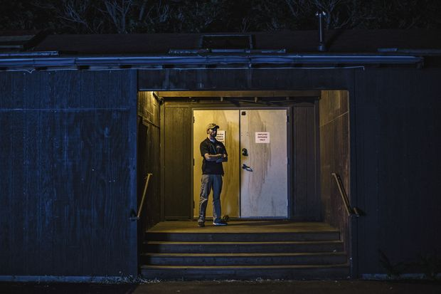 Chris Bowyer, with Iron Protection Group, on a night shift providing security at The Herbal Cure, a marijuana shop and grow house in Denver, Aug. 26, 2016. In Colorado, a curious marriage has formed between the booming cannabis industry and its young war veterans, more than 200 of whom of have taken jobs protecting marijuana businesses across the state. (Ryan David Brown/The New York Times)