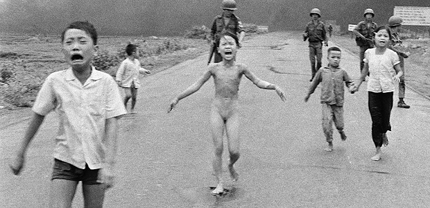 "FILE - In this June 8, 1972, file photo taken by Huynh Cong ""Nick"" Ut, South Vietnamese forces follow behind terrified children, including 9-year-old Kim Phuc, center, as they run down Route 1 near Trang Bang after an aerial napalm attack on suspected Viet Cong hiding places. On Monday, June 8, 2015, precisely 43 years later, Nick Ut returned to the same place to capture his memories with a tool from an entirely different era, a 4-ounce iPhone 5 equipped with the ability to send photos to the world in the blink of a digital eye. (AP Photo/Nick Ut, File) ORG XMIT: BKCD101"