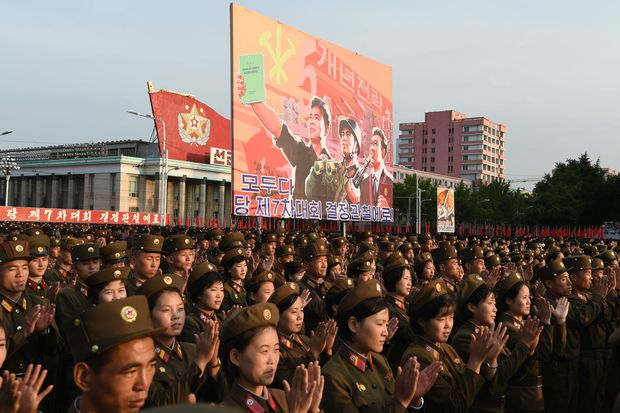 Soldiers applaud during a celebration rally attended by service members and civilians following the country's successful test of a nuclear warhead on September 9, in Kim Il Sung Square in Pyongyang on September 13, 2016. North Korea is ready to conduct another nuclear test at any time, South Korea's defence ministry said on September 12, just days after Pyongyang sparked worldwide condemnation with its fifth and most powerful test. / AFP PHOTO / Kim Won-Jin