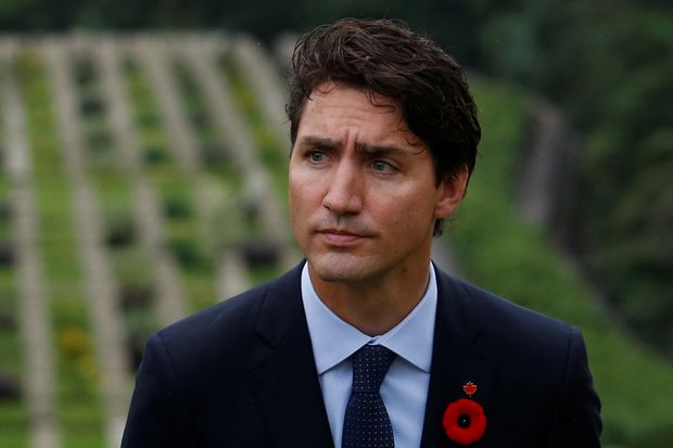 Canadian Prime Minster Justin Trudeau attends a wreath laying ceremony at Sai Wan war cemetery, where some Canadian soldiers who died in World War Two were buried, in Hong Kong, China September 6, 2016. REUTERS/Bobby Yip ORG XMIT: HKG09