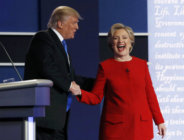 Republican U.S. presidential nominee Donald Trump greets Democratic U.S. presidential nominee Hillary Clinton after their first presidential debate at Hofstra University in Hempstead, New York, U.S., September 26, 2016. REUTERS/Brian Snyder -TPX IMAGES OF THE DAY ORG XMIT: HEM256
