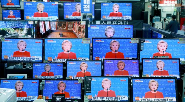 TV screens show the live broadcast of Democratic presidential nominee Hillary Clinton during the U.S. presidential debate with Republican presidential nominee Donald Trump, in Seoul, South Korea, Tuesday, Sept. 27, 2016. (Hong Hae-in/Yonhap via AP) KOREA OUT ORG XMIT: SEL801
