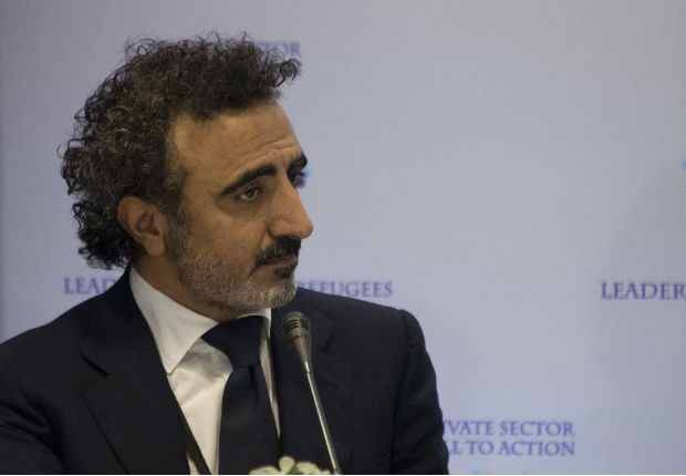 Chobani founder and Chief Executive Hamdi Ulukaya attends the CEO Roundtable at the United Nations General Assembly in New York on September 20, 2016. / AFP PHOTO / JIM WATSON ORG XMIT: JIM024