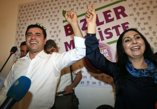 FILE-In this Sunday, June 7, 2015 file photo, Selahattin Demirtas, left, co-chair of the pro-Kurdish Peoples' Democratic Party, (HDP) and Figen Yuksekdag, the other co-chair celebrate following a news conference in Istanbul. regarding their party's success at the elections. Authorities in Turkey detained 11 pro-Kurdish lawmakers early Friday, Nov. 4, 2016 as part of ongoing terror-related investigations, including Demirtas, Yuksekdag and other senior officials, the Interior Ministry said. The government accuses the HDP of being the political arm of the outlawed Kurdistan Workers' Party, or PKK, which has fought an armed insurgency against the state for over three decades. The HDP rejects the accusation.(AP Photo/Lefteris Pitarakis, File) ORG XMIT: AXLP101