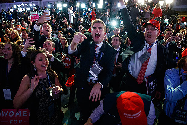 Supporters of Republican presidential candidate Donald Trump cheer as they watch election returns during an election night rally, Tuesday, Nov. 8, 2016, in New York. (AP Photo/ Evan Vucci) ORG XMIT: NYEV211