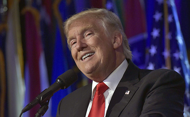 """(FILES) This file photo taken on November 9, 2016 shows President-elect Donald Trump speaking during election night at the New York Hilton Midtown in New York. Donald Trump will keep his vow to deport millions of undocumented migrants from the United States, he said in an interview to be broadcast November 13, 2016, saying as many as three million could be removed after he takes office. """"What we are going to do is get the people that are criminal and have criminal records, gang members, drug dealers, where a lot of these people, probably two million, it could be even three million, we are getting them out of our country or we are going to incarcerate,"""" Trump said in an excerpt released ahead of broadcast by CBS's 60 Minutes program. / AFP PHOTO / MANDEL NGAN"""