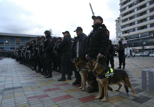 "Albanian Police forces line up in front of Elbasan Arena stadium where Albania will play their World Cup 2018 qualifying soccer match against Israel under tight security measures in Elbasan, 50 kilometers (30 miles) south of the capital, Tirana, Saturday, Nov. 12, 2016. Police have taken extreme steps after media reports that an alleged terror group of 15 persons, arrested in Albania, Kosovo and Macedonia, planned an attack during the match. The venue was changed for ""security reasons"" from the northern city of Shkoder to Elbasan. (AP Photo/Visar Kryeziu) ORG XMIT: XVK103"