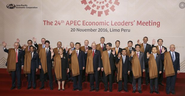 Leaders of Asia Pacific Economic Cooperation, APEC, wave during the group photo in Lima, Peru, Sunday, Nov. 20, 2016. Front row, from left: Australia's Prime Minister Malcolm Turnbull, Brunei's Sultan Hassanal Bolkiah, Canada's Prime Minister Justin Trudeau, Chile's President Michelle Bachelet, China's President Xi Jinping, Peru's President Pedro Kuczynski, Hong Kong's Chief Executive Leung Chun-ying, Indonesia's Vice President Jusuf Kalla, Japan's Prime Minister Shinzo Abe, South Korea's Prime Minister Hwang Kyo-ahn and Malaysia's Prime Minister Najib Razak. Back row, from left: Mexico's Secretary of Economy Ildefonso Guajardo, New Zealand's Prime Minister John Key, Papua New Guinea's Prime Minister Peter O'Neill, Philippines's Secretary of Department of Foreign Affairs Perfecto Yasay, Russia's President Vladimir Putin, Singapore's Prime Minister Lee Hsien Loong, Taiwan 's special APEC envoy James Soong, Thailand's Deputy Prime Minister Prajin Juntong, US President Barack Obama and Vietnam's President Tran Dai Quang. (AP Photo/Martin Mejia) ORG XMIT: XRM198