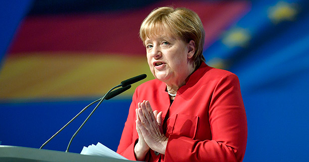 German Chancellor and Chairwomen of the CDU, Angela Merkel, gestures during her speech as part of a general party conference of the Christian Democratic Union (CDU) in Essen, Germany, Tuesday, Dec. 6, 2016. Merkel wants to secure the backing of her conservative party to head up the party's campaign for next September's election. (AP Photo/Martin Meissner) ORG XMIT: MME107