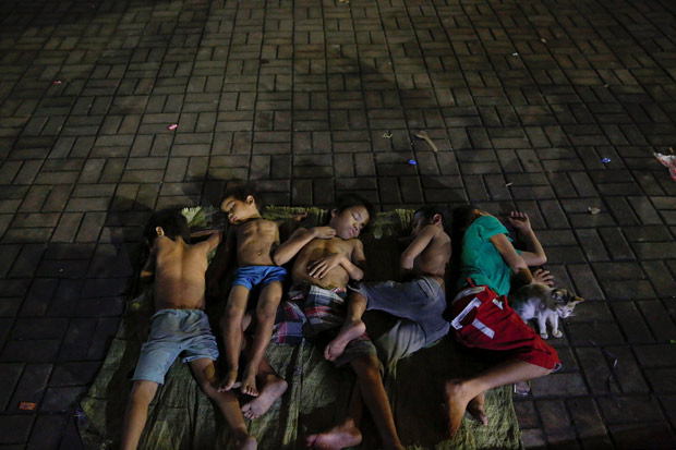 Children sleep on a square near a church in Manila, Philippines early October 18, 2016. People who have been spending their nights outside the church for a long time, say there are more people joining them since the beginning of the country's war on drugs. REUTERS/Damir Sagolj.