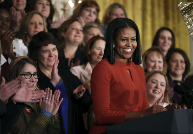 First lady Michelle Obama smiles as she speaks at the 2017 School Counselor of the Year ceremony in the East Room of the White House in Washington, Friday, Jan. 6, 2017. (AP Photo/Manuel Balce Ceneta) ORG XMIT: DCMC105