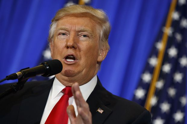 President-elect Donald Trump speaks during a news conference in the lobby of Trump Tower in New York, Wednesday, Jan. 11, 2017. (AP Photo/Evan Vucci) ORG XMIT: NYEV136