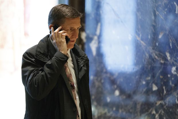National Security Adviser-designate Michael Flynn walks in the lobby of Trump Tower in New York, Thursday, Jan. 12, 2017. (AP Photo/Evan Vucci)