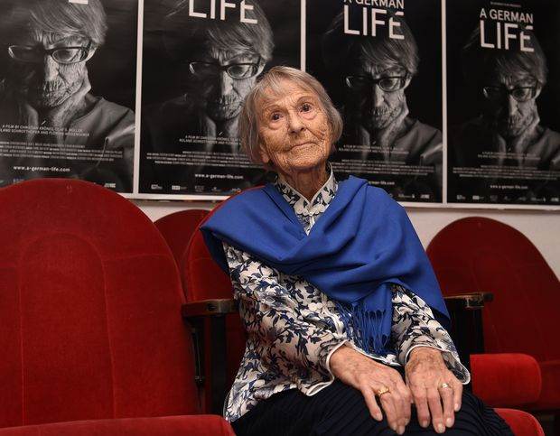 "This file photo taken on June 29, 2016 shows Brunhilde Pomsel, former secretary of Nazi propaganda chief Joseph Goebbels, sitting on a cinema chair in front of posters for the movie ""A German Life"" in a cinema in Munich, southern Germany. Brunhilde Pomsel died on January 27, 2017 at the age of 106, it was announced on January 30, 2017. / AFP PHOTO / ORG XMIT: CST002"