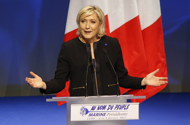 "Far-right leader presidential candidate Marine Le Pen gestures as she speaks during a conference in Lyon, France, Sunday, Feb. 5, 2017. Britain's decision to leave the European Union and the election of U.S. President Donald Trump have given the French a ""reason to vote"" because it can result in real change, the top lieutenant of far-right French presidential candidate Marine Le Pen declared Sunday ahead of her long-awaited speech. (AP Photo/Michel Euler) ORG XMIT: MEU111"