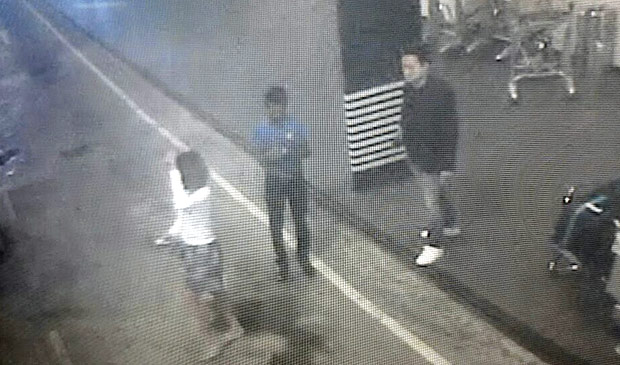This image provided by Star TV on Wednesday, Feb. 15, 2017, of closed circuit television footage from Monday, Feb 13, 2017, shows a woman, left, at Kuala Lumpur International Airport in Sepang, Malaysia, who police say was arrested Wednesday in connection with the death of Kim Jong Nam, the half brother of North Korean leader Kim Jong Un. (Star TV via AP) ORG XMIT: TKTT501