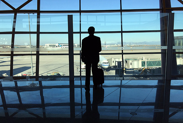 (170113) -- BEIJING, Jan. 13, 2017 (Xinhua) -- Photo taken with a mobile phone shows a passenger waiting to board at Beijing Capital International Airport T3 in Beijing, capital of China, Jan. 13, 2017. About 2.98 billion trips are expected to be made during China's 2017 Spring Festival travel rush between Jan. 13 and Feb. 21. The figure represents an increase of 2.2 percent from the same period in 2016. The Spring Festival, or Chinese Lunar New Year, falls on Jan. 28 this year. The festival is the most important occasion for family reunions. (Xinhua/Chen Jianli) (swt)