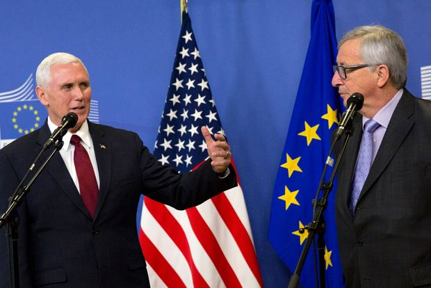 US Vice-President Mike Pence (L) speaks during a press conference with with European Commission President Jean-Claude Juncker at the European Commission in Brussels on February 20, 2017. Pence sought to reassure Europe of Donald Trump's commitment to transatlantic ties as he met EU chiefs in the face of anti-Trump protests. / AFP PHOTO / POOL / Virginia Mayo ORG XMIT: VLM118