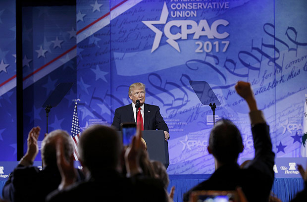 U.S. President Donald Trump is welcomed prior to addressing the American Conservative Union's annual Conservative Political Action Conference (CPAC) in National Harbor, Maryland. U.S., February 24, 2017. REUTERS/Kevin Lamarque ORG XMIT: WAS101