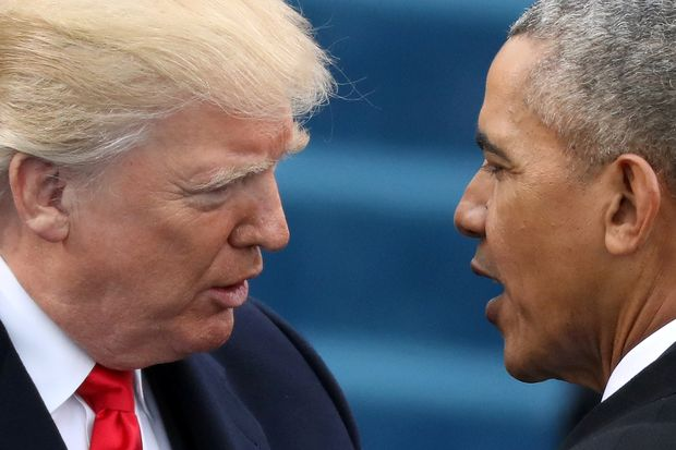 FILE PHOTO: U.S. President Barack Obama (R) greets President-elect Donald Trump at inauguration ceremonies swearing in Trump as president on the West front of the U.S. Capitol in Washington, U.S., January 20, 2017. REUTERS/Carlos Barria/File Photo ORG XMIT: SIN200