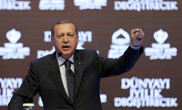 "Turkey's President Recep Tayyip Erdogan talks during a rally in Istanbul, Sunday, March 12, 2017. The escalating dispute between Turkey and the Netherlands spilled over into Sunday, with a Turkish minister unable to enter her consulate after the authorities there had already blocked a visit by the foreign minister, prompting Erdogan to call the Dutch fascists. Erdogan said at the rally: ""I had said that Nazism has risen from the grave. I said 'I thought Nazism was over but I was wrong.' In fact, Nazism is alive in the West."" (AP Photo} ORG XMIT: XLP104"