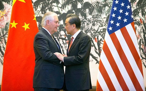 U.S. Secretary of State Rex Tillerson, left, and Chinese Foreign Minister Wang Yi stare at each other as they shake hands at the end of a joint press conference following their meeting at the Diaoyutai State Guesthouse in Beijing, China, Saturday, March 18, 2017. Tillerson pushed for closer China-U.S. cooperation on dealing with North Korea's nuclear program in his first face-to-face talks Saturday with leading Chinese diplomats. (AP Photo/Mark Schiefelbein, Pool) ORG XMIT: XMAS124
