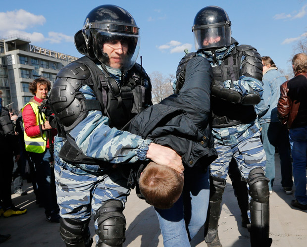 "Police detain a protester in downtown Moscow, Russia, Sunday, March 26, 2017. Russia's leading opposition figure Alexei Navalny and his supporters aim to hold anti-corruption demonstrations throughout Russia. But authorities are denying permission and police have warned they won't be responsible for ""negative consequences"" or unsanctioned gatherings. (AP Photo/Alexander Zemlianichenko) ORG XMIT: MOSB115"
