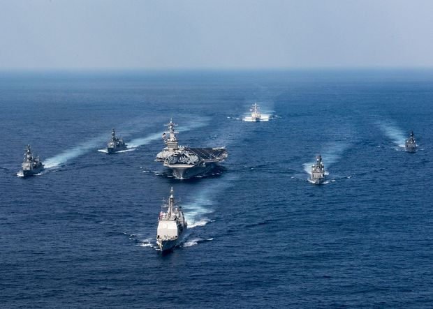 This US Navy photo obtained March 31, 2017 shows the Nimitz-class aircraft carrier USS Carl Vinson (CVN 70), Arleigh Burke-class guided-missile destroyer USS Wayne E. Meyer (DDG 108) and Ticonderoga-class guided-missile cruiser USS Lake Champlain (CG 57) as they participate in a photo exercise with Japan Maritime Self-Defense Force destroyers on March 28, 2017 in the Philippine Sea. The Carl Vinson Carrier Strike Group is on a western Pacific deployment as part of the US Pacific Fleet-led initiative to extend the command and control functions of US 3rd Fleet. ( / AFP PHOTO / US NAVY / MCS 3rd Class Matt BROWN / RESTRICTED TO EDITORIAL USE - MANDATORY CREDIT AFP PHOTO /US NAVY/MCS 3RD CLASS MATT BROWN - NO MARKETING - NO ADVERTISING CAMPAIGNS - DISTRIBUTED AS A SERVICE TO CLIENTS ORG XMIT: USS Carl Vinson (CVN 70)