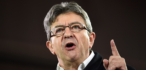 French presidential election candidate for the far-left coalition La France insoumise Jean-Luc Melenchon delivers a speech during a campaign meeting in Lille on April 12, 2017. / AFP PHOTO / Philippe HUGUEN