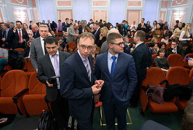 Members of Jehovah's Witnesses wait in a court room in Moscow, Russia, on Thursday, April 20, 2017. Russia's Supreme Court has banned the Jehovah's Witnesses from operating in the country, accepting a request from the justice ministry that the religious organisation be considered an extremist group, ordering closure of the group's Russia headquarters and its 395 local chapters, as well as the seizure of its property. (AP Photo/Ivan Sekretarev) ORG XMIT: XIAS102