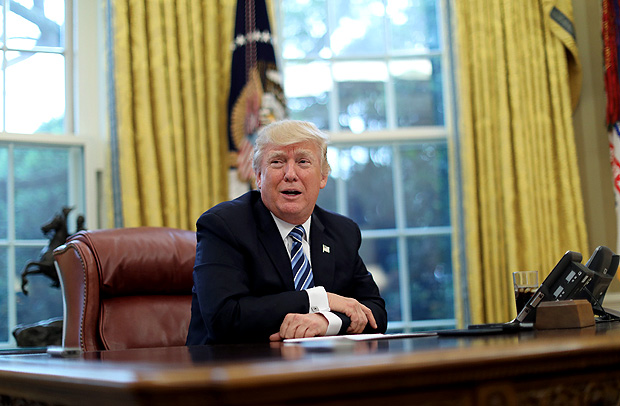 U.S. President Donald Trump speaks during an interview with Reuters in the Oval Office of the White House in Washington, U.S., April 27, 2017. REUTERS/Carlos Barria ORG XMIT: WAS304