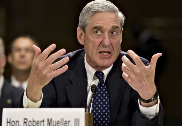 In this June 19, 2013, file photo, former FBI Director Robert Mueller testifies on Capitol Hill in Washington. On May 17, 2017, the Justice Department said is appointing Mueller as special counsel to oversee investigation into Russian interference in the 2016 presidential election. (AP Photo/J. Scott Applewhite, File) ORG XMIT: WX121
