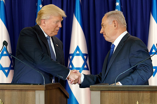 President Donald Trump shakes hands with Israeli Prime Minister Benjamin Netanyahu after making joint statements, Monday, May 22, 2017, in Jerusalem. (AP Photo/Evan Vucci) ORG XMIT: ISRV146