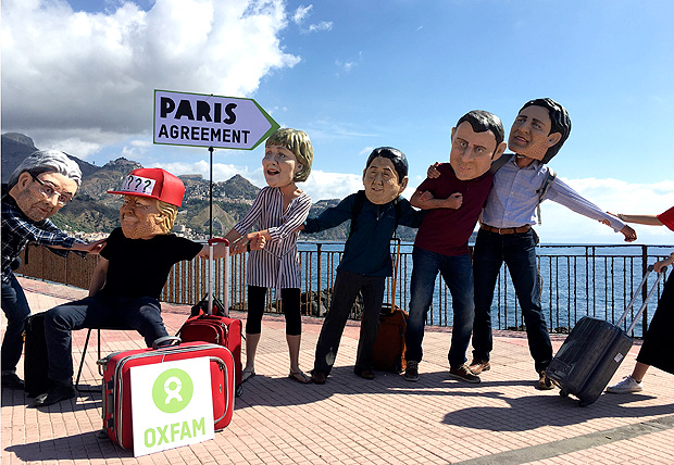 Oxfam activists wearing masks of the leaders of the G7 summit; from left, Italian Premier Paolo Gentiloni, US President Donald Trump, German Chancellor Angela Merkel, Japanese Prime Minister Shinzo Abe, French President Emmanuel Macron and Canadian Prime Minister Justin Trudeau, stage a demonstration in Giardini Naxos, near the venue of the G7 summit in the Sicilian town of Taormina, southern Italy, Friday, May 26, 2017. Climate change promises to be the most problematic issue for this summit after Trump's decision to review U.S. policies related to the Paris Agreement on fighting global warming. (AP Photo/Paolo Santalucia) ORG XMIT: ROM110