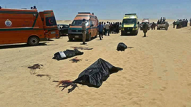 This image released by the Minya governorate media office shows bodies of victims killed when gunmen stormed a bus in Minya, Egypt, Friday, May 26, 2017. Egyptian officials say dozens of people were killed and wounded in an attack by masked militants on a bus carrying Coptic Christians, including children, south of Cairo. (Minya Governorate Media office via AP) ORG XMIT: CAIMA108
