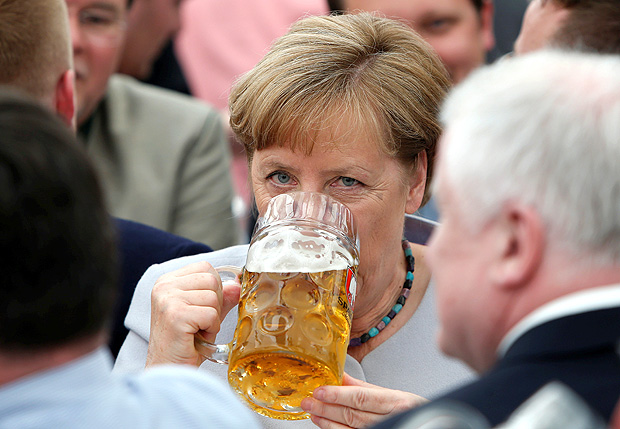 German Chancellor and head of the Christian Democratic Union (CDU) Angela Merkel drinks during the Trudering festival in Munich, Germany, May 28, 2017. REUTERS/Michaela Rehle ORG XMIT: REH01