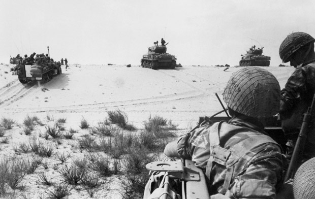 (FILES) This file photo taken on June 5, 1967 shows Israeli armored forces in action in the Sinai Desert. In six days in 1967 Egypt's vaunted airforce was destroyed and its army humbled. Egyptians never overcame the shock of that defeat to Israel that spelled the end of their country's regional dominance. / AFP PHOTO / AFP FILES / STRINGER ORG XMIT: DOC