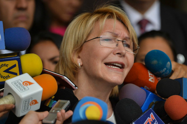 Venezuela's attorney general Luisa Ortega speaks to journalists outside the Supreme Court of Justice headquarters building in Caracas on June 13, 2017. Venezuela's Supreme Court on Monday rejected a legal challenge by attorney general Luisa Ortega against the government's constitutional reform bid in a deadly political crisis. / AFP PHOTO / LUIS ROBAYO ORG XMIT: LRO004