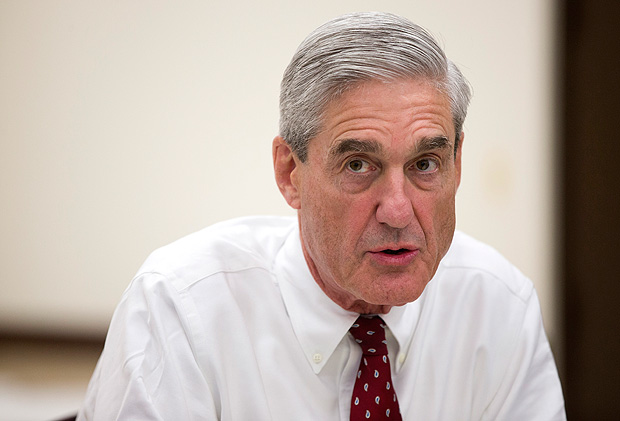 FILE - In an Aug. 21, 2013 file photo, outgoing FBI director Robert Mueller speaks during an interview at FBI headquarters, in Washington.Muller, the special counsel investigating possible ties between President Donald Trump's campaign and Russia's government has taken over a separate criminal probe involving former Trump campaign chairman Paul Manafort, and may expand his inquiry to investigate the roles of the attorney general and deputy attorney general in the firing of FBI Director James Comey, The Associated Press has learned.(AP Photo/Evan Vucci, File) ORG XMIT: WX115