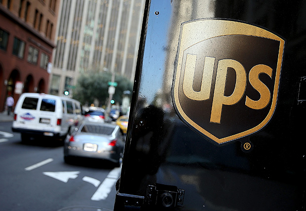 """(FILES) This file photo taken on October 23, 2014 shows a United Parcel Service logo displayed on a delivery truck in San Francisco, California. A US judge ordered the American shipping giant UPS to pay $247 million to New York state and city governments, for shipments of cigarettes that illegally evaded taxes. Federal district court judge Katherine Forrest found UPS """"liable in each claim"""" and therefore the city and state """"are entitled to compensatory damages and penalties,"""" according to court documents. / AFP PHOTO / GETTY IMAGES NORTH AMERICA / JUSTIN SULLIVAN"""