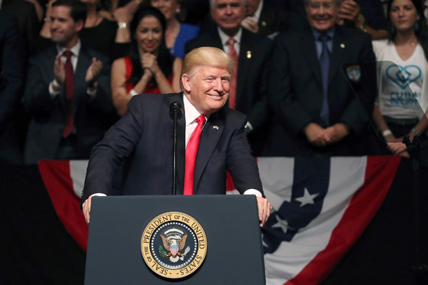 MIAMI, FL - JUNE 16: U.S. President Donald Trump speaks about policy changes he is making toward Cuba at the Manuel Artime Theater in the Little Havana neighborhood on June 16, 2017 in Miami, Florida. The President will re-institute some of the restrictions on travel to Cuba and U.S. business dealings with entities tied to the Cuban military and intelligence services. Joe Raedle/Getty Images/AFP == FOR NEWSPAPERS, INTERNET, TELCOS & TELEVISION USE ONLY ==